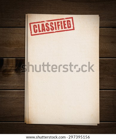 Block of old papers with classified stamp. - stock photo
