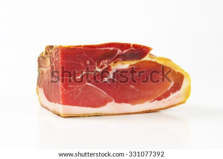 block of prosciutto - italian dry-cured ham on white background