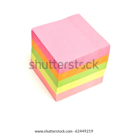 Block of vibrant multicoloured Post it Notes isolated on white. - stock photo