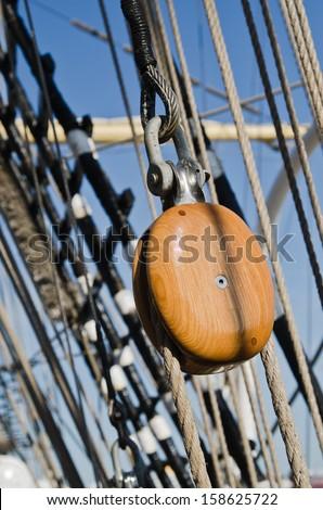 Blocks and rigging at the old sailboat, close-up - stock photo