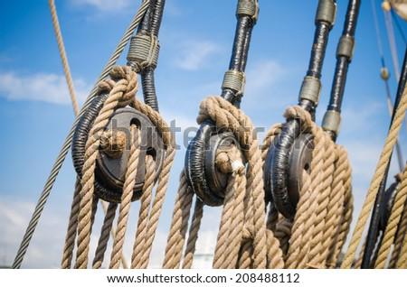Blocks and tackles of a sailing vessel, close up - stock photo