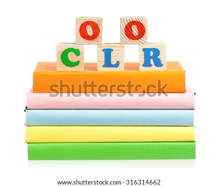 Blocks for kids on books isolated on white background - stock photo