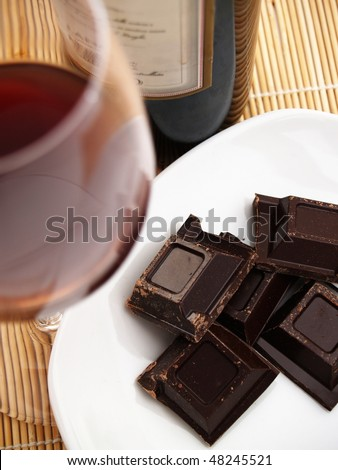 blocks of chocolate and glass of wine - stock photo