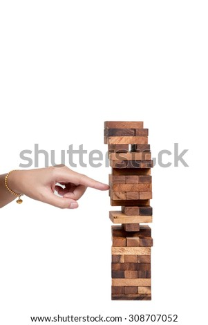 Blocks of wood and woman hand isolated on white background, - stock photo