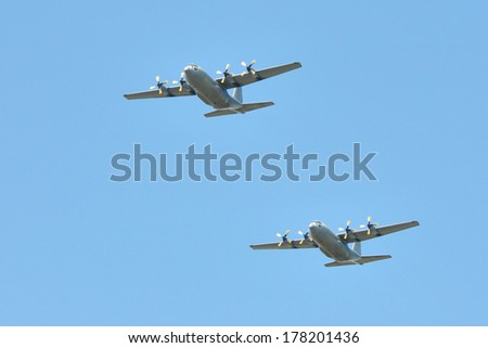 BLOEMFONTEIN, SOUTH AFRICA - February 2014: The Armed Forces parade the streets of Bloemfontein on February 21st, 2014 to commemorate World Armed Forces Day. Two hercules C130 aircraft fly by