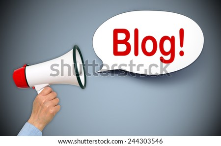 Blog ! - female hand with megaphone and speech bubble - stock photo