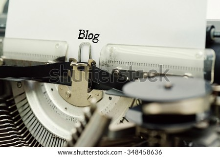 Blog - Paper Sheets in Old Vintage Typewriter . Business concept on Toned, Grain Effect, Shallow Depth Of Field and Blurred Background - stock photo