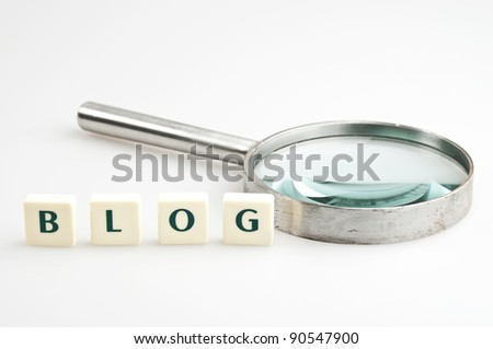 Blog word and magnifying glass