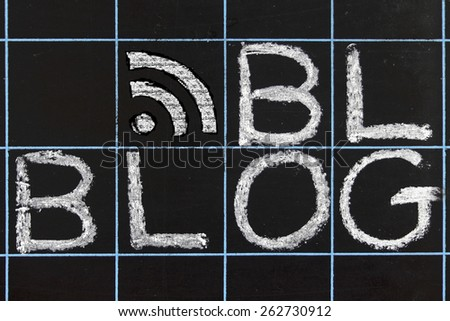 blog word handwritten on a blackboard - stock photo