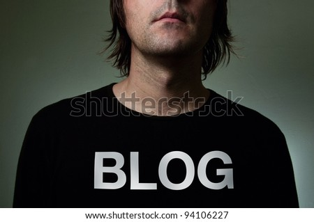 Blogger with hidden identity in a black shirt with title BLOG on T-shirt - stock photo