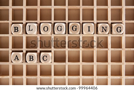 Blogging ABC words construction with letter blocks / cubes and a shallow depth of field - stock photo