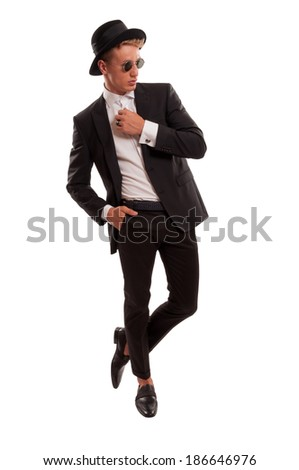 Blond and beautiful male model posing dressed with designer clothes, showing attitude lean on his back - stock photo