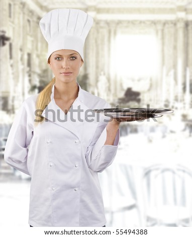 blond and young woman in white chef dress with hat - stock photo