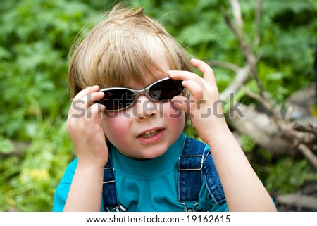 Blond beautiful funny boy with sunglasses