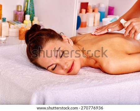 Blond beautiful woman getting massage. Vision hand. - stock photo