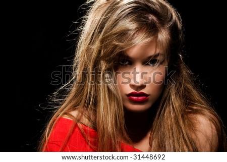 blond beautiful woman looking wilde - stock photo