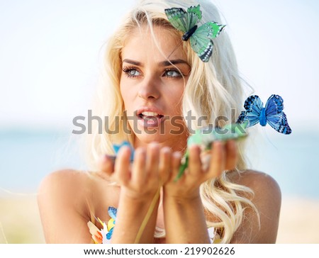 Blond beauty and butterflies - stock photo