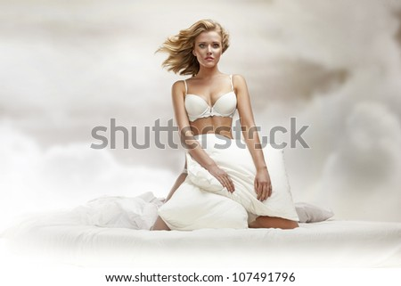 Blond beauty in sky - stock photo