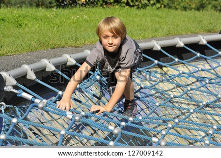 Blond boy on the playground.
