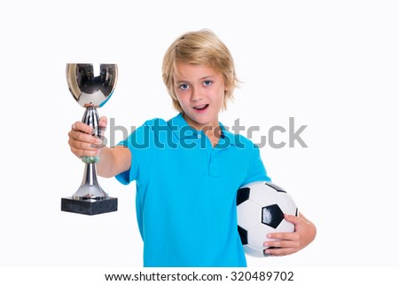 blond boy with soccer ball and cup in front of white background - stock photo