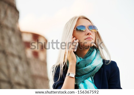 Blond business woman calling on the phone  - stock photo