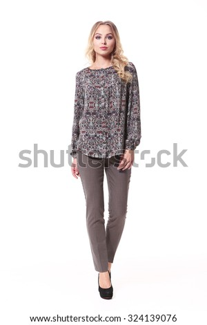 blond business woman in casual blouse and trousers isolated on white - stock photo