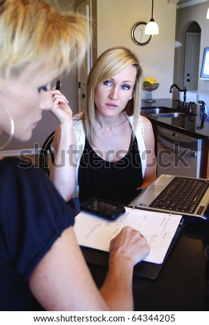 Blond business women at home office - stock photo