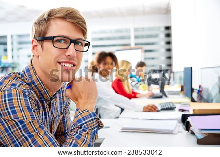 Blond businessman young in office with computer in a desk row - stock photo