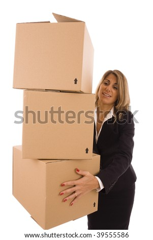Blond businesswoman carrying three cardboard boxes - stock photo