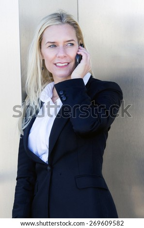 blond businesswoman on the phone - stock photo