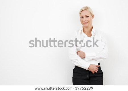 Blond businesswoman on white with laptop - stock photo