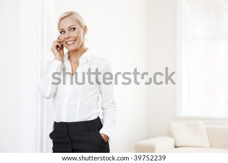 Blond businesswoman with mobile - stock photo