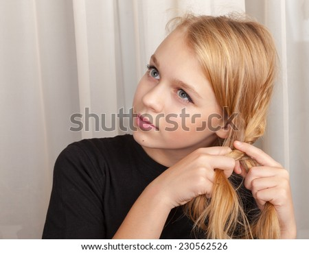 Blond Caucasian girl braids plait, close up  portrait - stock photo