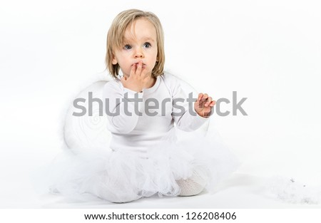 blond child in a christmas angel costume - stock photo
