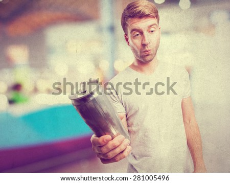 blond drunk man with beer - stock photo