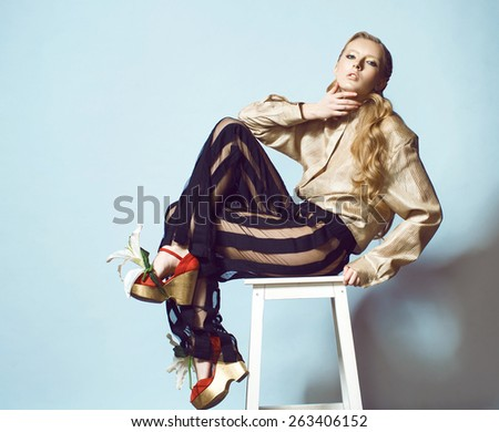 blond fashion woman trousers strips blouse jacket shoes with flowers - stock photo