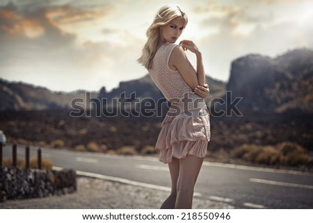 Blond fashionable woman - stock photo