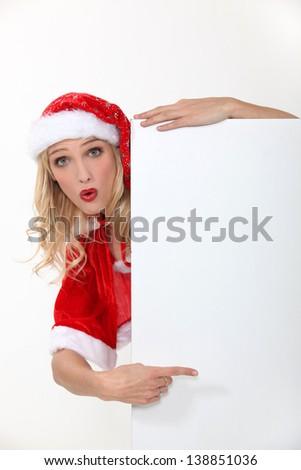 Blond female in Santa costume - stock photo