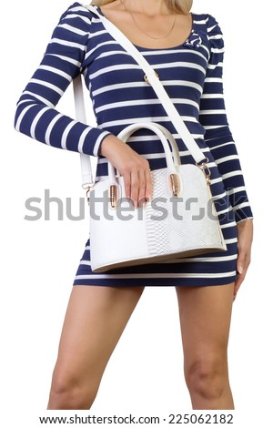 Blond female with leather bag  - stock photo