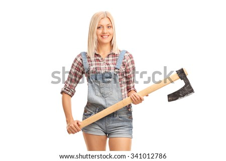 Blond female worker in jumpsuit and checkered shirt holding an axe and looking at the camera isolated on white background - stock photo