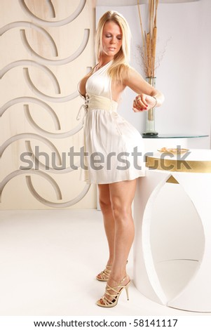 Blond gets ready for a date - stock photo