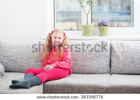 blond girl at home - stock photo