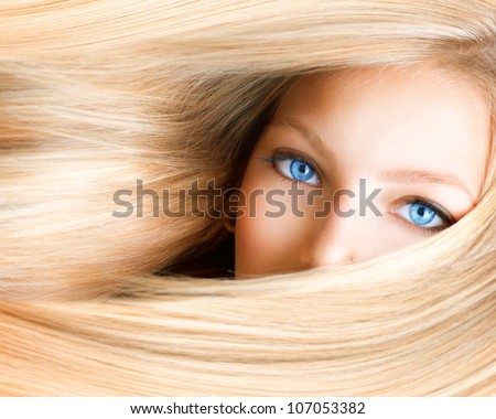 Blond Girl. Blonde Woman with Blue Eyes. Healthy Long Blond Hair. Hair Extension - stock photo