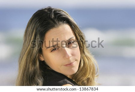 blond girl in a blue background - stock photo