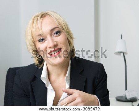blond girl in a suit smiling