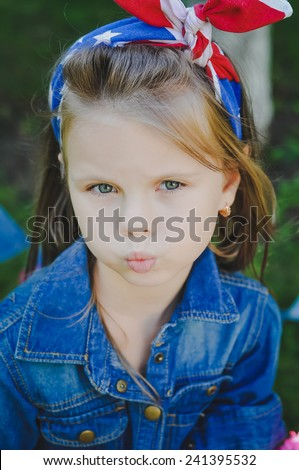 Blond girl in casual jeans cloth outdoors  in american flag bandana - stock photo