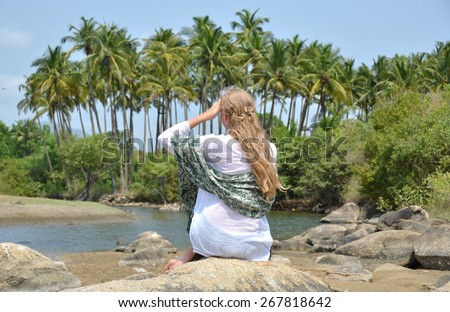 Blond girl relaxing on Agonda beach of South Goa, India - stock photo