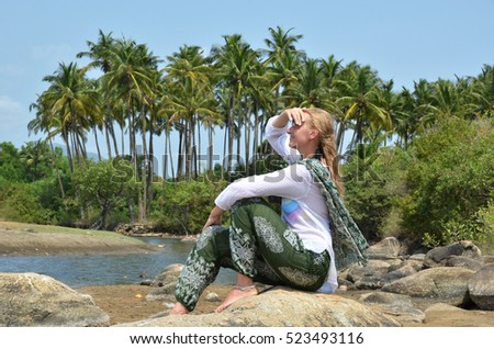 Blond girl relaxing on Agonda beach of South Goa, India