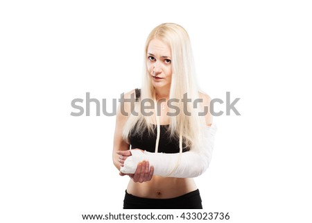 Blond girl with a broken arm in plaster looking sad - stock photo