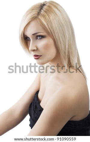 Blond girl with hair style and elegant black dress posing over white with jewellery, she is turned of three quarters to the left